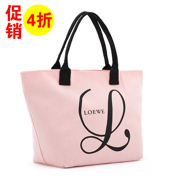 Romantic woman sporting pink canvas small satchel bag 0125
