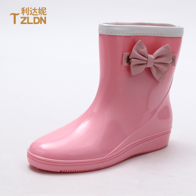 2014 spring tide angel rain boots women fashion boots overshoes Korea pink bow Duantong water shoes garden shoes