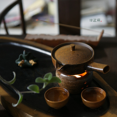 Japanese kung fu tea set Coarse pottery boiling tea stove ceramic teapot. Surround furnace heat heating coarse ceramic tea set