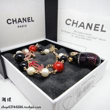Moscú, vacío de muñecas rusas placas colgantes de perlas pulsera de Chanel chanel estilo no es alérgica