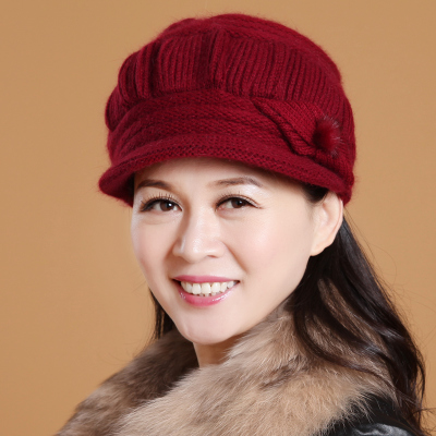 Elderly woman in winter hat to keep warm in the elderly lady rabbit ear hat winter line cap elderly mother cap