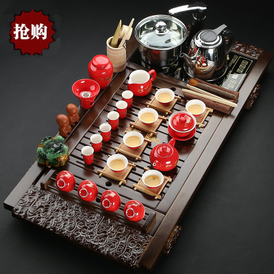 Special packages mailed Violet arenaceous kung fu ceramic tea set four unity of a complete set of induction cooker solid wood tea tray tea sea