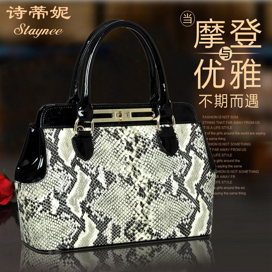 香港诗蒂妮漆皮撞色手提包 亮皮蛇纹女包2013新款 锁扣牛皮真皮包 价格:379.00