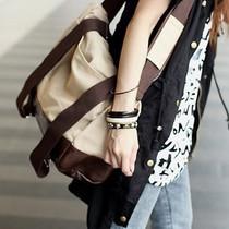 蘑菇街女包新品包包2013新款潮女帆布包运动包中包斜跨包韩版包邮 价格:59.50