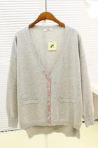 2013韩版女装 宽松不规则彩色扣子前短后长手臂补丁毛衣针织开衫 价格:69.00
