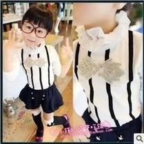 童装女童2013秋款 黑色蝴蝶结 白色高领打底衫 女孩衬衫 价格:42.00