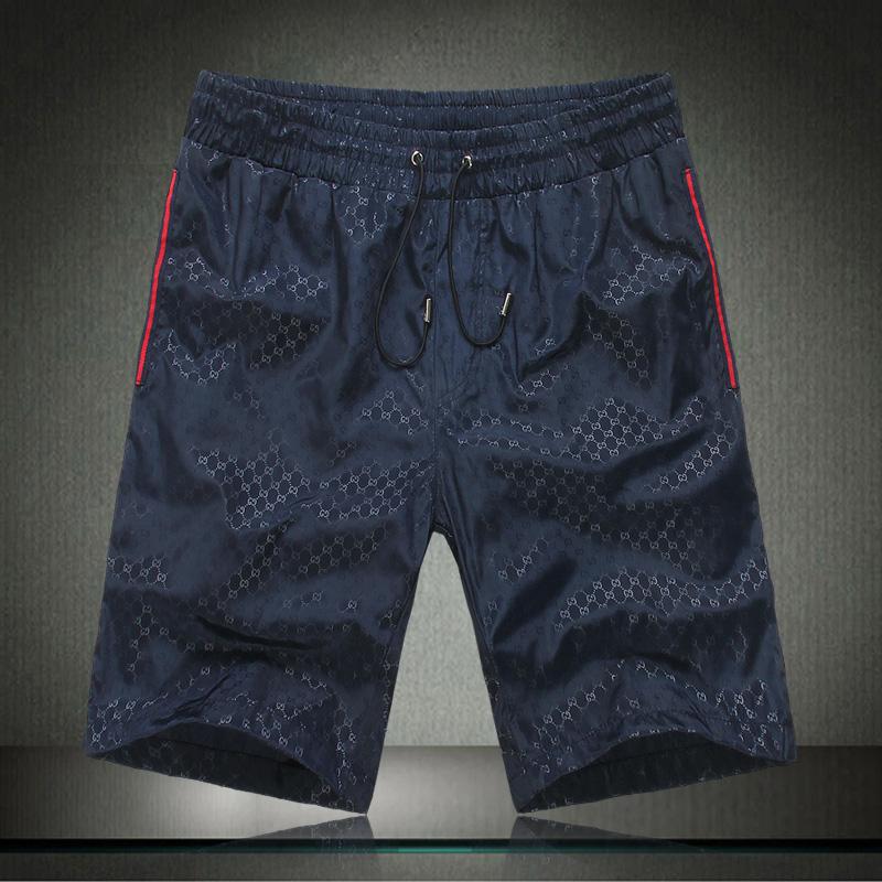 Gucci/酷奇短裤男2013新款男装古驰男士休闲中裤夏季沙滩裤五分裤 价格:138.00