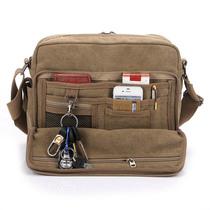 帆布包 男 多功能单肩斜跨包 休闲背包工具包商务文件包多兜包包 价格:57.00