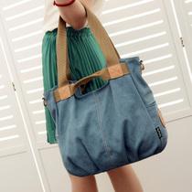 韩版女士单肩包斜跨包手提包背包2013新款复古潮 休闲帆布包女包 价格:58.80