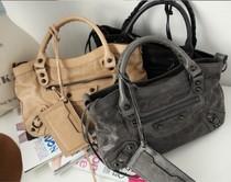 2013新款韩国代购正品女装韩版流苏拉链铆钉羊皮真皮包机车包女包 价格:630.00