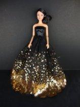 有许多金色亮片作以适合芭比娃娃最令人惊异黑衣服The Most Amaz 价格:198.00