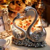 包邮 现代简约时尚家居装饰品摆设欧式恩爱天鹅复古树脂镀银摆件 价格:58.00
