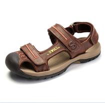 公牛世家 男款凉拖2013新款高档皮质雨季洞洞鞋牛皮男鞋沙滩鞋 价格:659.00