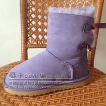 2013新品绑带蝴蝶结5825羊皮毛一体雪地靴中筒女靴梦幻紫栗色靴 价格:268.00