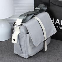 新品情侣包韩版男女包包休闲包帆布包单肩包男士学生书包潮包包特 价格:39.00