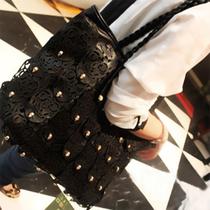 2013新款韩版铆钉骷髅头个性女包 编织手提单肩欧美复古黑色大包 价格:69.00