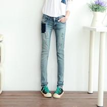 2013春装新款 炭灰色破洞贴布女士牛仔裤 显瘦小脚裤 价格:79.89