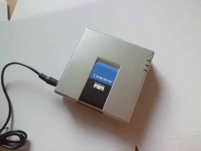 Шлюз VOIP Linksys pa2t/na  LINKSYS PAP2T